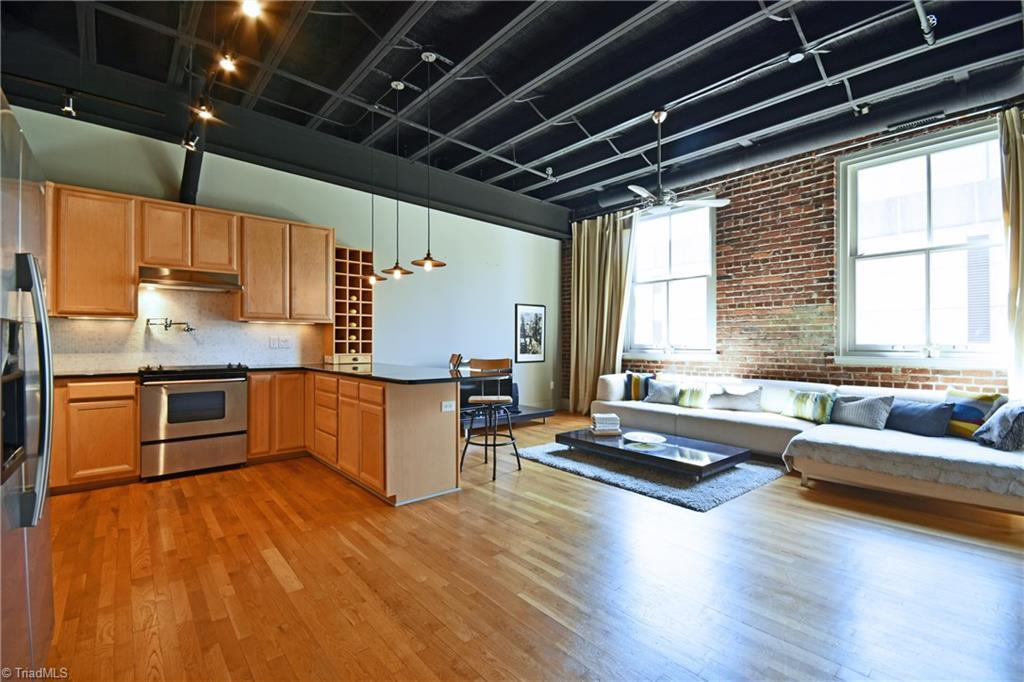 Beautifully updated downtown condo in Historic Charles Building includes exposed beams, brick walls, wood floors, and tremendous high ceilings. Open floor plan, perfect for entertaining. Enjoy large rooftop deck with dramatic views of Innovation Quarter and Downtown. One block from Arts District. Walking distance to everything that downtown has to offer. Secured parking in enclosed garage. Fantastic investment in heart of thriving downtown. Schedule your tour today!