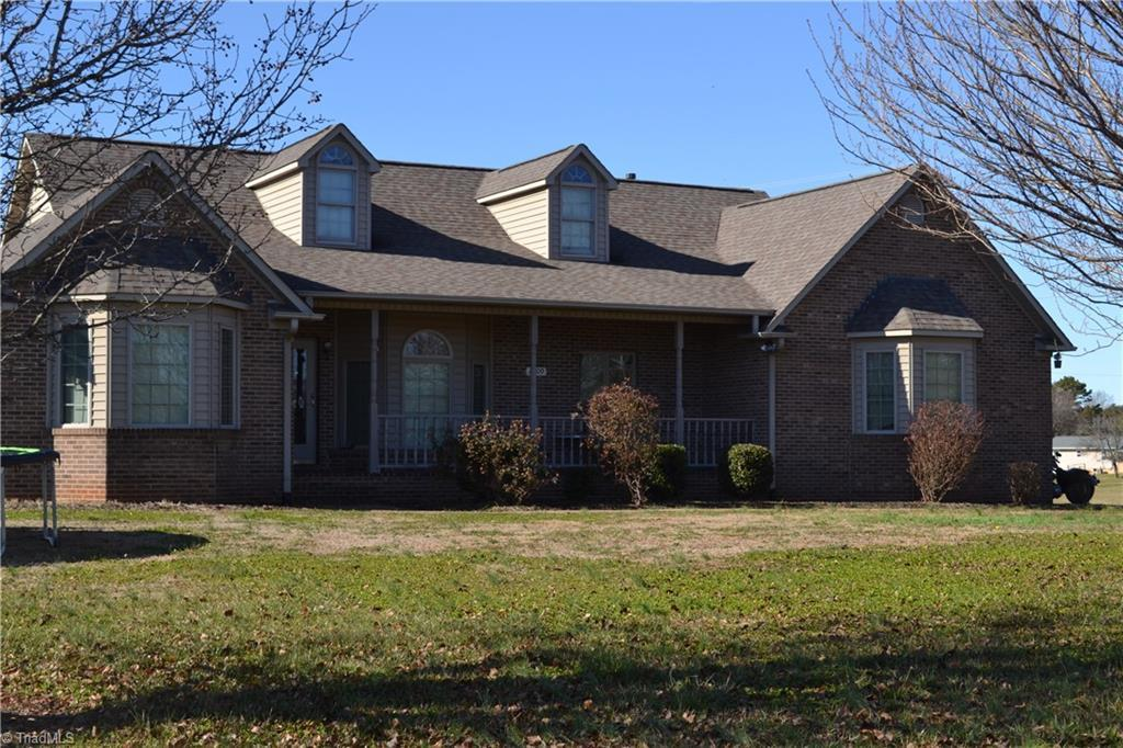 Beautiful Brick home located on the 18th fairway at Yadkin Country Club. One level  home with beautiful hardwood floors throughout.  Open floor plan with fireplace in living room.    Gorgeous Sunroom with lots of windows to look out on golf course.  Or sit on the huge deck overlooking the golf course.   Split bedroom plan, private master bedroom/closets/bathroom with jetted tub.  Nice size eat in kitchen adjoining dining room with beautiful bay window.  Large garage, outside building.