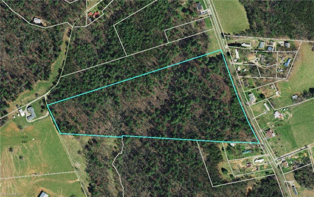 Great country landscape with wooded acreage and some mature timbers.  Great property for a new home, farm use, or investment property.  Mostly flat with multiple building sites and no restrictions.  Close to North Wilkes Middle School and only minutes from downtown North Wilkesboro and shopping.