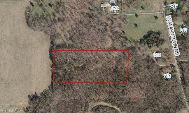 6.77 Acres off of Howardtown Road in Mocksville. Sitting about 500' off of the street with a private easement for access. This parcel would make a great homesite with promising soil types for a septic system or for farming. Great views backing up to a larger agriculture farm. Easy access to Highway 158 and Interstate 40. Low County taxes and convenient to Mocksville & Winston Salem.