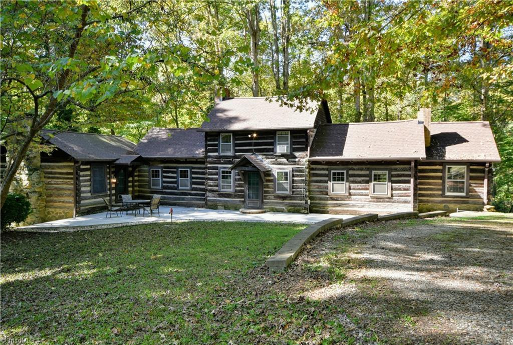 """PRICED $100,000 BELOW TAX VALUE! Extremely unique restoration opportunity to step back in time in this historic log cabin just 12 minutes from downtown. See attachments for the history of this truly enchanting setting. Exterior features include 3 Patios, BBQ pit w/slate patio, rock & slate walkways, 3 car log garage. Outdoor fireplace on rock-walled grass patio. Walk down to the creek to find the old stone """"pool"""". Interior charm abounds & boasts 7 fireplaces! Wood floors (some recently refinished) & wonderful natural light for a log cabin of this age. Spa"""