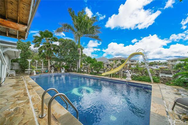 Beautiful Hawaii Kai Marina frontage. This 5 bedroom 4 bath home features a sparkling pool and a lar