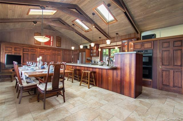 NEW LISTING!! Spectacular, panoramic Diamond Head, ocean and Manoa valley views await you from this beautifully updated and immaculately maintained 5 bedroom + den/3 bath home in highly desirable Manoa Valley.  Nestled at the end of a quiet street for maximum privacy, this home features almost 3,000 sq. ft. of living space, hardwood floors, and an updated kitchen with vaulted ceilings, granite counter tops and Brazilian Cherry cabinets. The bottom level offers 2 bedroom/1 bath with a wet bar and separate entrance, perfect for extended family living.  You'll appreciate the highly coveted Manoa neighborhood just minutes from schools, parks, and Manoa Marketplace with shopping & restaurants.