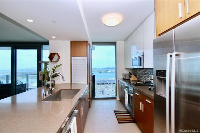 Rarely available end unit conveniently located in Kakaako, Honolulu across the street from the Salt
