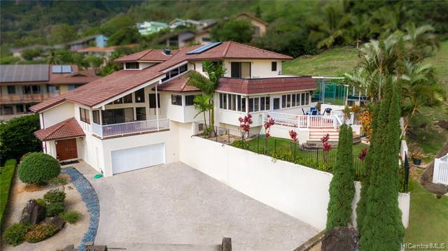 Enjoy sweeping ocean, mountain and valley views from this custom designed 5 bed / 3.5 bath executive home updated in 2019 with fresh interior paint and new vinyl plank flooring. Located on a desirable cul de sac, this property includes a large family room, spacious and open living room, enclosed multi-purpose room, and private lanai off master bedroom that makes an ideal layout for family gatherings and entertainment.  