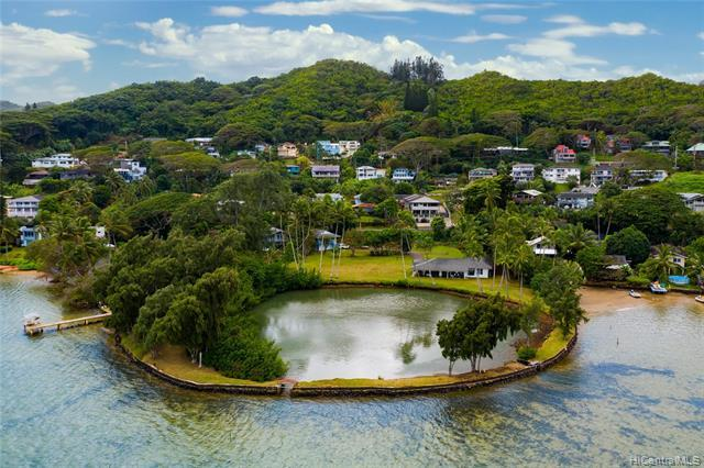 "A rare ocean-side estate situated on Kaneohe Bay.  This expansive 2.52 acre parcel zoned R-5 & P-1 includes 2 dwellings and a private fishpond.  The main home is a single level 3BD/2 Bath w/ breathtaking views of the water, coastline, and Chinaman's Hat.  Featuring 2 lg lanais and designed for indoor / outdoor living.  The 2nd dwelling is a  2-story 2BD/ 1 Bath cottage w/ a full kitchen & workshop area which can potentially be converted into additional living space.  Don't miss this opportunity to acquire a unique parcel of land to use as a private estate or for possible development opportunities.  Conveniently located minutes Windward Mall,and only 15 miles from downtown Honolulu.  Enjoy country living w/ quick, easy access to ""city life""."