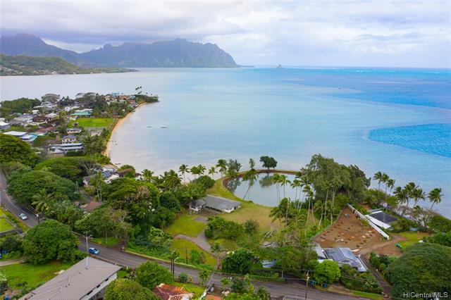 Situated on Kaneohe Bay, this 2.52 acre parcel zoned R-5 & P-1 includes 2 dwellings and a private fishpond.  The main home is a single level 3BD/2 Bath w/ breathtaking views of the ocean and Chinaman's Hat.  Featuring 2 lg lanais and designed for indoor / outdoor living.   The 2nd dwelling is a  2-story 2BD/ 1 Bath cottage w/ a full kitchen, 1 car garage, and workshop area that has the potential to be converted into additional living space.  This property is ideal for someone looking to acquire a unique parcel of land for a private estate, or for those searching for a property to develop or enhance.  Minutes from Windward Mall and only 15 miles from Downtown Honolulu.  Enjoy country living with quick and easy access to the conveniences of ""