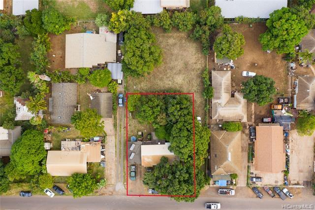 Endless possibilities for developers!  This large and level 10,020 sq ft lot is zoned R-5 ideal for a duplex, large family compound, or subdivide into two properties.  The property has ample onsite parking with a driveway and carport.  Street parking is also available.  Located minutes from world renown Makaha Beach with white sand, clear waters, and great surf!  The Waianae Boat Harbor and hang gliding activities are nearby.  There are many adventurous family activities. This is a must see property.  Call today for a private showing! http://youtu.be/JcYMw-IZyAM