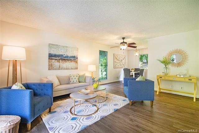 NEW LISTING! Enjoy majestic Ko'olau views from this rarely available 3 bdrm/1 bath END unit townhome with 2 parking in peaceful Ahuimanu Gardens in Kaneohe.  With almost 1,000 sq ft of interior living space, this unit features vinyl flooring, fresh interior paint, new carpet, a fenced/gated private patio perfect for entertaining, and a location in the project which provides for maximum privacy! Situated just minutes from Ko'olau Center, restaurants, shopping and entertainment...hurry this won't last!