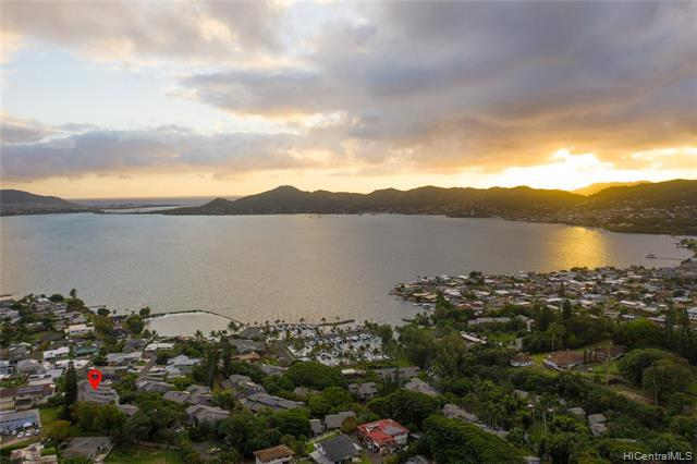 EXCLUSIVE YACHT CLUB LIVING W/ 34 FT DEEDED BOAT SLIP!! Makani Kai Marina, a private/gated community on the shores of Kaneohe Bay, is one of the windward side's best kept secrets. This gem is a large 3 bed, 2 bath townhome with nearly 1,500 interior square feet with 3 large lanai areas. Unit was recently upgraded with a sparkling new kitchen with high end appliances, paint, and carpet. Features include quartz countertops, high vaulted ceilings, open concept layout, perfect for entertaining or relaxing. As soon as you enter the gated complex, you'll notice the tropical landscaping and plentiful amenities, including a rec room, pool, grilling/picnic area, and plenty of guest parking. This complex is pet friendly (2 limit; no weight restrictio