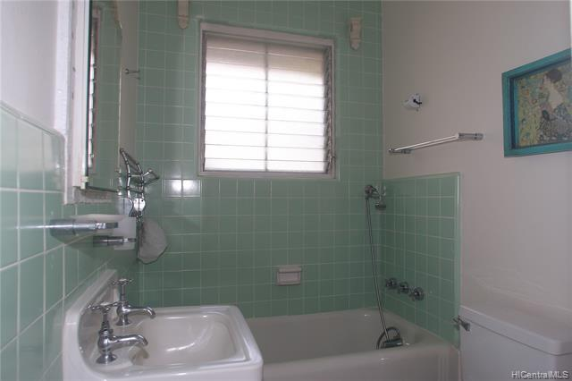 Bathroom #2 in the residential wing - bathtub and a shower stall.