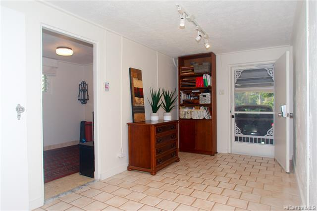 Lower level 1 bedroom 1 full bath w. shower, plus laundry/service room and a private entrance from the lower level garage.  Currently used as a home fitness room- but it is perfect for guests or other creative uses.