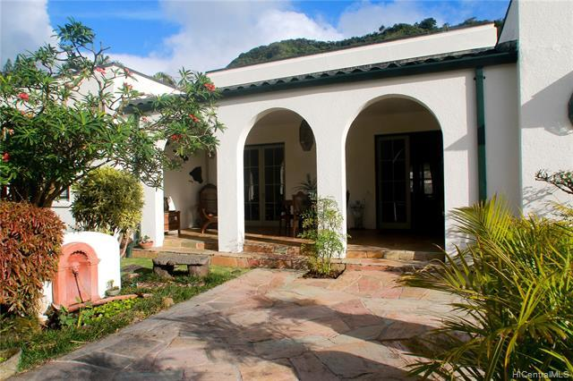 Front landscaped courtyard leads to a shaded and cool front lanai.