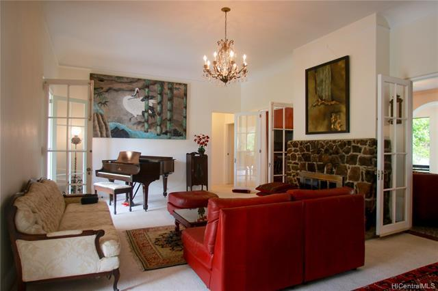 Grand living room features 11 ft. ceilings, generous sized doors for natural lights and a fireplace.