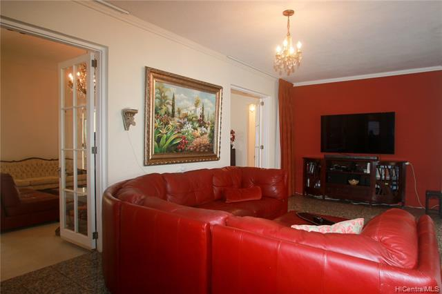 Living room flows seamlessly into the family/entertainment room that has the entrance to the garden...