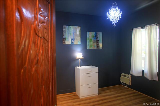 Bedroom #2 w. designer colors and beautiful solid wood carved doors.