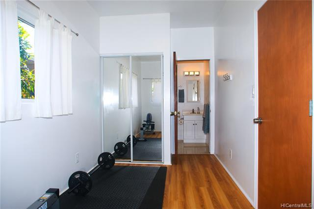 Main Bedroom Suite is currently used as a home gym.  However, it could be utilized in so many ways via it's own back entrance; gym, art studio or separate rental.