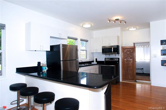 Modern black granite top open concept kitchen w. newer S/S appliances.  Lots of natural light and ventilation makes cooking a delight.