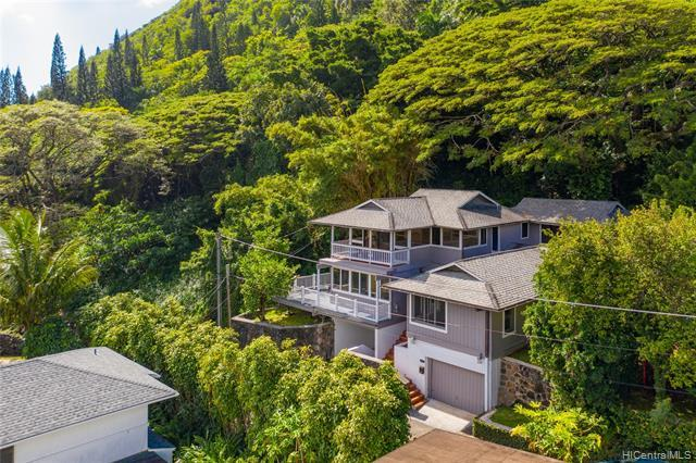 Imagine waking up every morning to a majestic Manoa Valley view while watching the sun rise over Wa'ahila Ridge. Nicely updated and well maintained, this 4 bedroom/4 bath gem is situated on a tropically wooded lot and located at the end of a quiet lane for maximum privacy. With almost 2500 square feet of living space, you'll have ample room for everyone in the family. The lower level offers a formal living room, a beautifully remodeled kitchen/family room and two bedrooms, one ensuite. Upstairs are two more bedrooms, both ensuite, with the glorious valley view from the master. You'll love this highly coveted Manoa neighborhood, just minutes from UH, schools, shopping, restaurants and easy access to downtown.