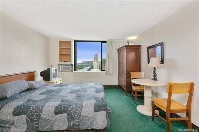 High floor studio with gorgeous Ala Wai canal and ocean views. Long time rental unit with some upgra