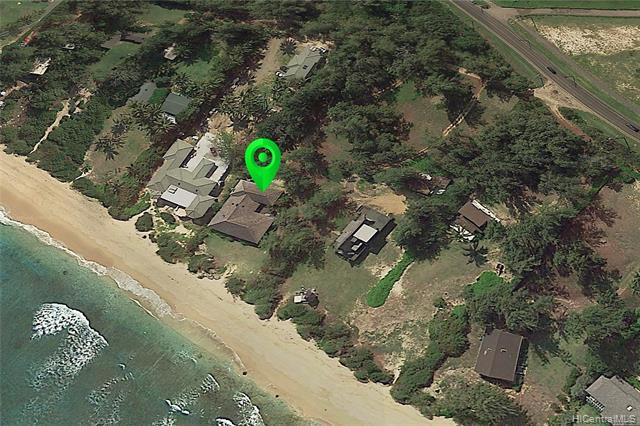 NEW LISTING!! There are very few places on earth that provide the magical feeling of Malaekahana Bay. This hidden oasis allows you step back in time, to old Hawaii, when spending quality time at the beach with friends and family were the norm. This expansive 60,112 sq ft seaside estate is fronted by wide seamless white sand beaches.  The large 5 bedroom 3 bath home features an open floor plan w/vaulted ceilings, stunning panoramic ocean views, wrap around decks, a large loft area, and a separate 2 bedroom 1 bath guest quarters. Sun, surf, sand, and fun await you at this once in a lifetime opportunity.