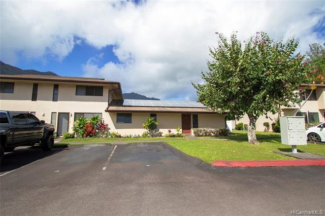 Great for 1st time home  owners!  Conveniently located across the street from Koolau Center (Times, McDonalds, Theaters & more) with easy access to Kahekili Highway and bus lines, this 3/2 single level townhouse has been upgraded with 34 owned  PV panels.   Enjoy views of the Koolau mountains , the convenience of 2 parking stalls right out front, the extra space with 2 fenced patios and the accessibility of a large playground within view.  VIRTUAL TOUR NOW AVAILABLE - Click on the link/icon to view thru Matterport