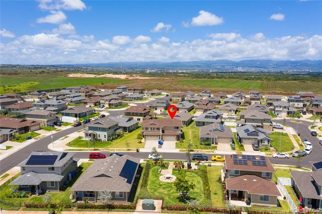 """Enjoy the newly built master planned community of Ho'opili! This Plan 1 """"Plantation"""" model at Iliahi was built in 2018. Immaculately maintained 3-bedroom, 2.5 bath home features an open concept kitchen and living room with kitchen island and access to covered backyard patio. Developer installed luxury vinyl plank flooring, tankless gas water heater, and outdoor gas BBQ stub-out give the home a modern and contemporary feel. With high end stainless steel appliances, matching fans in the living room and bedrooms, and full size side by side washer and dryer this home is move in ready and perfect for relaxing or working from home. The enclosed 2 car garage has been seal coated for easy cleaning and maintenance and the large driveway allows for a"""