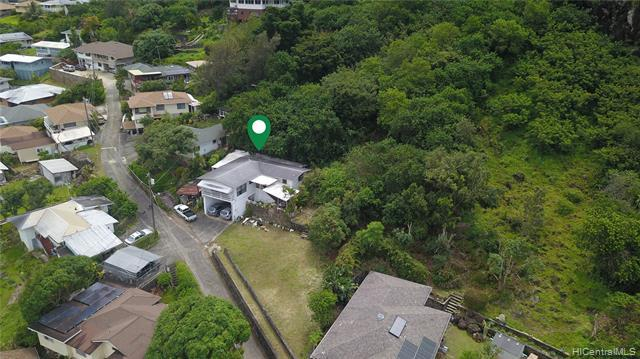 "OPPORTUNITY KNOCKS! This is an extremely rare opportunity to build your dream home and/or renovate the existing residence. Tucked away in lush Palolo Valley, this residence is conveniently located near bus lines, schools, stores, and restaurants that feels like country living -- best of both worlds! This 3bdrm/1.5 bath residence sits on 1.77 acres with 37,436 sqft in R-5 zoning, ready to develop, and offers endless possibilities.  Priced well under the assessment value and to sell! Property is being sold in ""as is"" condition. Do not go on property unattended."