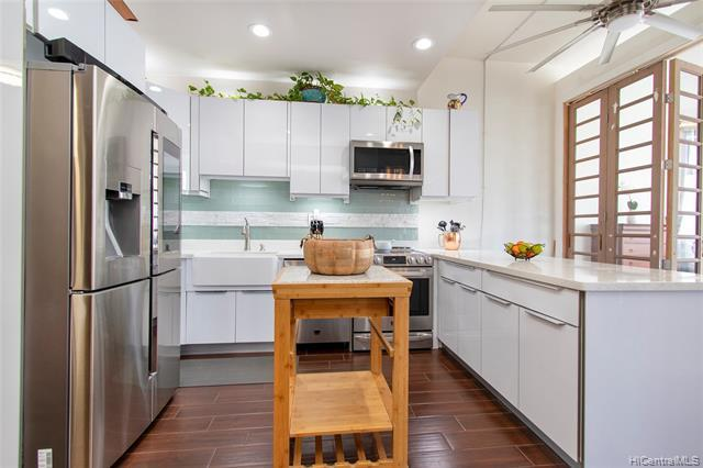 What makes this fabulous penthouse rare is that comes with 2 covered prkg spaces, one of which  is extra-large. Right in the heart of Honolulu with stunning city, Diamond Head & ocean views, 1.2 miles distance from the beach, even closer to the Honolulu Museum of Art, Blaisdell Concert Hall & Arena, Salt at our Kaka'ako, Downtown, Queens Medical Center and Straub. This corner end unit was totally remodeled with high end tasteful finishes, such as quartz counter tops, porcelain tile floors throughout, stainless steel appliances, custom kitchen cabinets with soft close drawers and doors. The fully remodeled bath has floor to ceiling tile, river rock shower floor, rain shower head and pedestal sink. Additional features include over-sized Fanim
