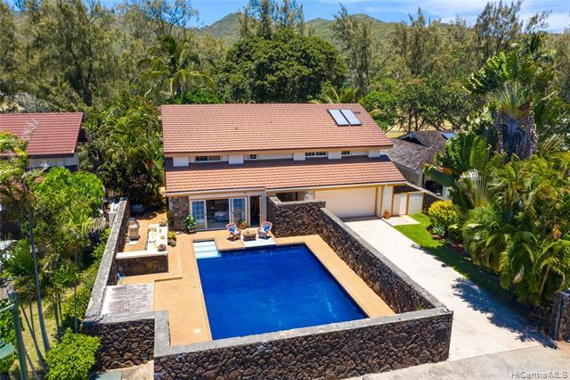 PRIME GOLF COURSE FRONTAGE on the 1st hole of the Hawaii Kai Championship Golf Course! This SPACIOUS 3000+ sq ft executive-style 2-story home is located in the exclusive Queens Gate neighborhood.  Relax in your very own PRIVATE OASIS, boasting 4 spacious bedrooms, each with its own en suite bathroom, and ample space for your family and guests. Features include a huge sparkling tiled pool, moss rock wall for added privacy, a fifth full-sized guest bathroom with a built-in sauna, renovated kitchen, newer high quality aluminum roof, expansive great room with marble tile floors, vinyl sliding doors and windows, high vaulted ceilings & more! Enjoy living your best life in Hawaii Kai, just a stroll away from the famous Sandy Beach and minutes fro