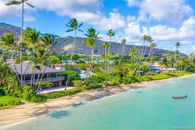 Island living at its FINEST. BREATHTAKING panoramic ocean, shoreline, and mountain views await you from this beautifully maintained 4 bdrm/3 bath + den OCEANFRONT residence located in the HIGHLY coveted Niu Beach.  Main residence features 3 bdrm/2 bath + den with soaring ceilings, koa finishes throughout, fresh interior/exterior paint, an updated open kitchen, tastefully upgraded bathrooms, new roof, and an expansive wrap around lanai from which to enjoy cool ocean breezes & stunning views.  An additional BONUS, a 1 bdrm/1 bath in-law's quarters on the lower level with separate entry!  Your Island Oasis awaits you, ideal for kayaking, stand up paddling, or just a quiet stroll along the beach.  Located just minutes from the shopping, restaur
