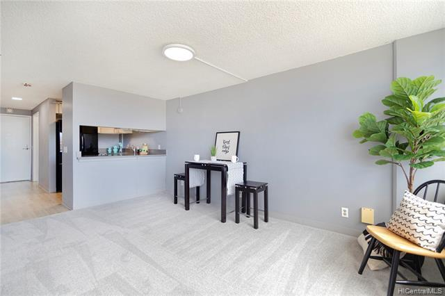 NEW LISTING in Plaza at Century Court! This IMMACULATE 2 bed/1 bath/1 parking (covered and secure) unit features a sleek, modern kitchen renovation with quartz counters & new cabinets, new luxury vinyl & carpet flooring throughout, fresh paint, and an extra-large master bedroom with walk-in closet. Enjoy cool trade wind breezes and beautiful Diamond Head and Waikiki views from this spacious condo (actually on the 7th floor) with over 700 sq ft interior. PRIME LOCATION off Kapiolani Blvd just minutes from Waikiki, Ala Moana Shopping Center, Downtown Honolulu, the University of Hawaii at Manoa, restaurants, shopping, parks, beaches and more! PET-FRIENDLY building (please verify) with a pool and washer/dryer in-unit.  Do not let this RARE OPPO