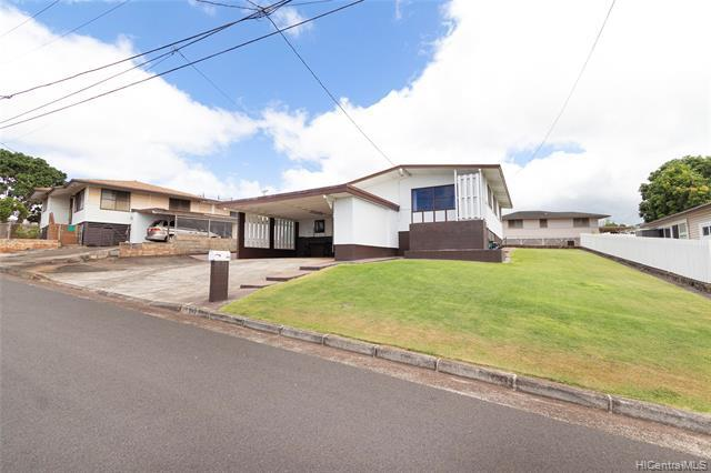 NEW LISTING! RARELY AVAILABLE & well maintained 3 bed 1.5 bath home located in a preferred neighborhood within Pearl City. This home features over 1,150 sqft interior on over 6,000 sqft of land, ocean views, parking for 3 or more cars, a spacious grassy yard, bonus space under the home & more! Upalu street is off the main drag so car traffic and noise is minimal, comparatively. This home is centrally located just minutes away from Pearl Highlands Center, Pearl Ridge Shopping Center, Pearl Harbor, restaurants, schools and parks. A MUST SEE!