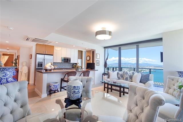 Unobstructed views of the ocean, coastline, harbor, reef runway & Aloha Tower are on offer from this luxurious 3 Bed, 2 Bath corner end unit. Enjoy watching cruise ships dock from your Wrap Around Lanai with views from ocean to mountain, & even Diamond Head!  This impeccably maintained condo features a gorgeous kitchen with Bosch appliances, stylish cabinetry, quartz counters, floor to ceiling windows, split A/C, custom closet in the owner's suite, two corner pking stalls & a storage locker. Resort style amenities incl rec deck w/pool, spa, fitness center, bbq area, & lounge. Truly a must see!