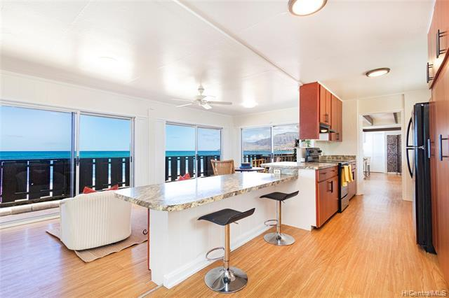 Kitchen overlooking the dining area..work remotely from your counter and enjoy the ocean views.