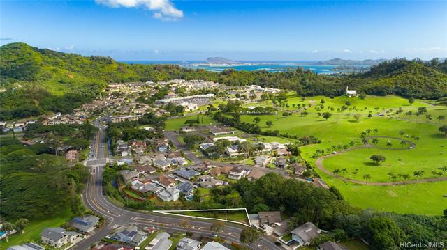This is an AMAZING and UNIQUE Opportunity to buy the only Vacant Lot on Hui Iwa St. Located in a fantastic family neighborhood, right before you turn up into Ahuimanu Hills, below the gorgeous Koolau Mountains.  Property is part of a 3 unit CPR. Seller's plans to build changed. Seller currently has sewer approval, building plans and an open permit at DPP. Click on Supplements for Plans, Condo Map and CPR Docs. Buyer to do their own due diligence on the build-ability of the lot. Seller Please do not walk on property without making an appointment. Line in photos are for illustrative purposes only and should not be construed as actual property line.
