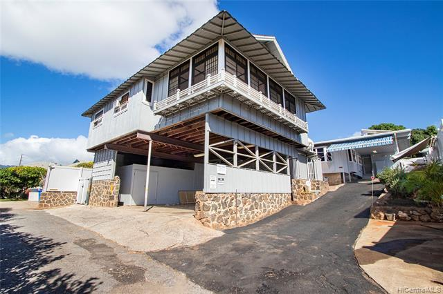 New Listing! Rare Opportunity to own 2 detached homes on an over 7,400 sq ft lot in one of Honolulu's most convenient neighborhoods, Kapahulu! Possibilities are endless. Live in one & rent the other OR have a family compound. The back home is a 2 bdrm + spacious den and 3 bath residence featuring a chef's kitchen with Thermador stainless steel appliances, gas grill and large eat-in island.  Other features include split ACs, 34 owned PV panels, and an outdoor wet bar with a granite countertop, ideal for entertaining. The front home is a 4 bdrm/2 bath home with a 2-car carport, lots of storage space and beautiful ocean and Diamond Head views. Conveniently located minutes from KCC, Waikiki, shopping, and restaurants.  Must see!