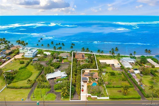 Take a glimpse at this private oceanfront estate in the heart of Waialua.  Pocket doors on the 1st level recreation area open to the ocean breeze, pool, and a large front yard perfect for entertaining.  After a long day surfing and swimming in the ocean or pool escape upstairs and enjoy the open concept kitchen and living area or watch the sunset into the horizon on the front deck. Upstairs you will also find three bedrooms, three baths, and a office perfect for WFH with an ocean view.  If it happens to be raining outside and a pool day isn't possible put your feet up and a movie on in the home theater. This home is the perfect escape for anyone.   This will be sold together with the neighboring parcel 1-6-7-13-32.  Land square footage lis