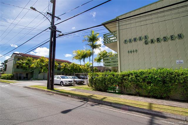 Rarely available 2 bed/1 bath corner unit with assigned parking. Recently updated with new carpeting, vinyl flooring, kitchen cabinets, and interior paint. Large lanai with washer, dryer, utility sink and storage. Minutes away from UH Manoa, schools, shopping, restaurants, freeway, beaches and more. LOW MAINTENANCE FEES. Perfect for a first home or investment purchase. Photos have been virtually staged. Ask listing agent for more info.