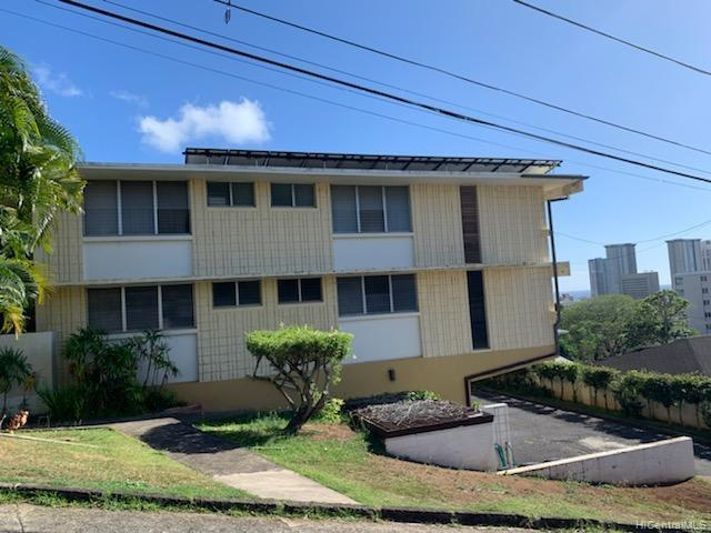 RARE FIND - 3 bedroom, 2 bathroom condo with 2 covered parking and storage. Low maintenance fees at $250 per month! Views of Downtown Honolulu and partial ocean views.