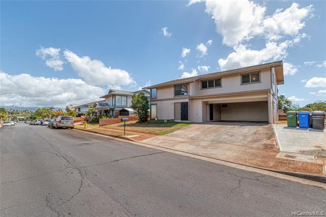 NEW LISTING! Don't miss this nicely upgraded and well maintained 5 bdrm/3 bath, 2-story home in Waipahu. Perfect for extended family living, the first floor offers 2 bdrms/1 bath with a wet bar and the upper level includes 3 bdrms/2 baths with a full kitchen. Features include fresh interior and exterior paint, new flooring, vaulted ceilings, and an expansive LEVEL backyard. Convenient location minutes from parks, school, restaurants shopping and entertainment. Hurry this one won't last long!