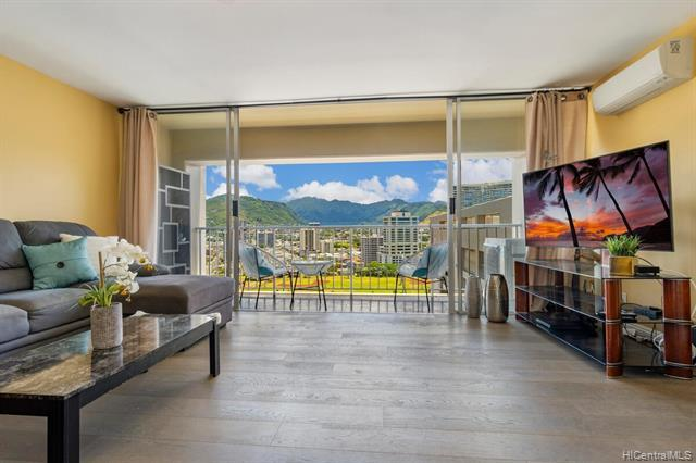 GORGEOUS MOUNTAIN & CITY VIEWS! This high floor right below the penthouse level, 2BR/1.5BA/1PGK condo is located on the cool side of the bldg and has the brilliant colors of city lights. A spacious and an efficient floor plan with a large open lanai to enjoy the open air living. Improvements include upgrades in kitchen, baths, luxurious engineered wood & marble tile floors, no popcorn ceiling, upgraded electrical panel & wiring throughout, installed 3 split ACs and many more to appreciate. Keoniana is a secured mid-rise residential bldg with short distances to the essential of the world's famous resort Waikiki location and a few steps away from the beach. This is a VA Approved bldg.