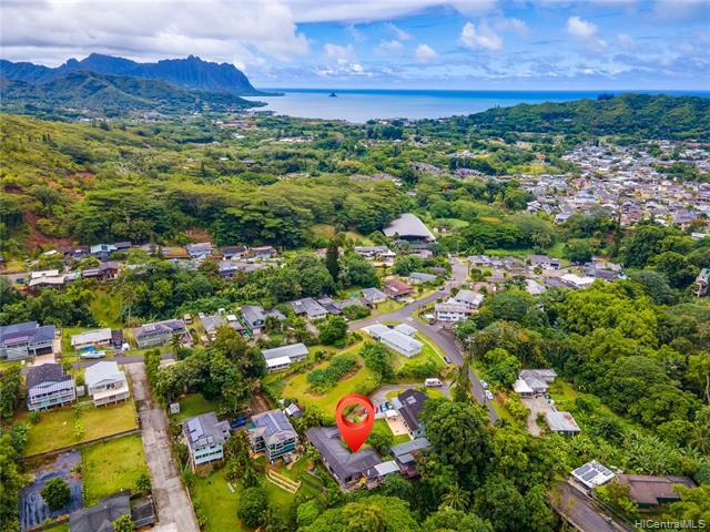 Nestled in GREEN, TROPICAL Ko'olau mountains, this BEAUTIFUL 3bed/2ba FAMILY home has UNSURPASSED VIEWS of MAGESTIC MOUNTAINS and WATERFALLS! Come home to SIZEABLE LAND surrounded by EXOTIC plants, FRUIT and FLOWER TREES.  Relax on your LARGE PATIO and enjoy the sounds of chipping birds and tranquil stream!  This breezy home has a LARGE DETACHED shed to create a home office or kids' play area AND a separate tool shed. This extremely private home is MOVE IN READY w/renovated kitchen, baths, laminate floors, NEW paint, PEST treatment, & split AC. Escape urban life today!