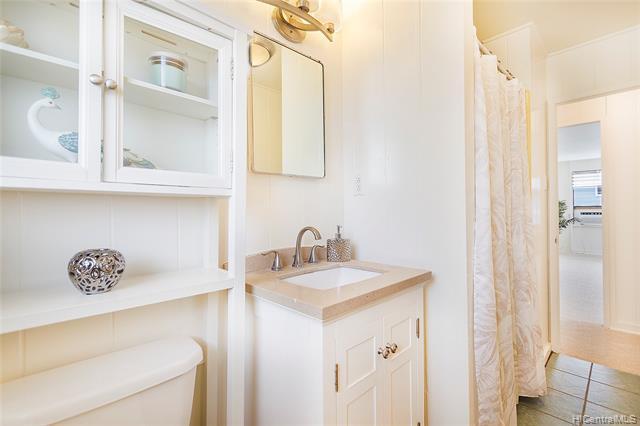 Clean and bright hallway bathroom with newer vanity