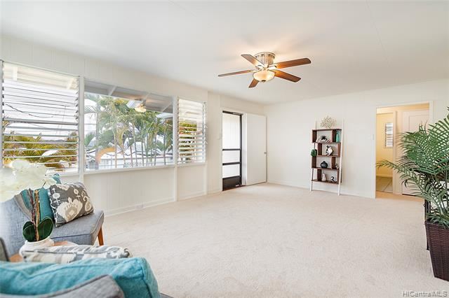 Spacious living area with brand new carpets.