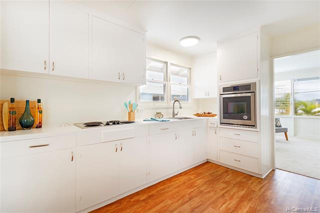 Kitchen with brand new stainless steel oven.