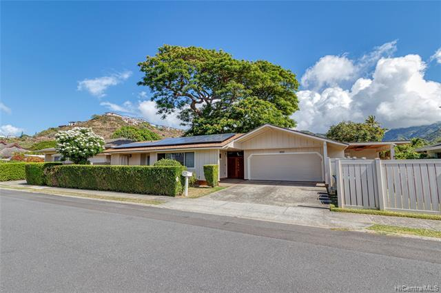 New Listing! RARE JEWEL! Exquisitely renovated and impeccably maintained 4 bdrm/3 bath SINGLE LEVEL home in the highly sought after Aina Haina neighborhood. Situated on a large 10,000 sq ft LEVEL lot, the main home offers 3 bdrms/2 baths with a spacious open floor plan and an enclosed patio ideal for indoor/outdoor entertaining PLUS enjoy the flexibility provided by a 1 bdrm/1 bath in-laws quarters/ADU with separate entry.  Features include fresh interior and exterior paint, multiple covered patios, 2 separate washers/dryers, and 18 owned PV panels with a net metering agreement. Conveniently located near beaches, parks and Aina Haina Shopping Center with shopping and restaurants. Don't miss this fantastic opportunity!