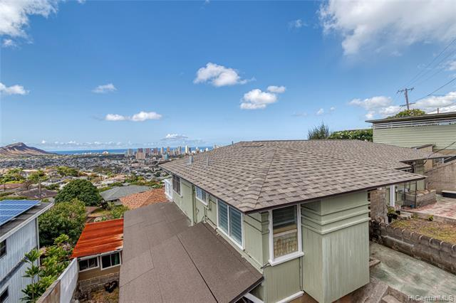 Awesome multi-family home!  Mid-way up St Louis Heights - corner of Felix and St Louis.  Wide street frontage and direct Diamond Head/Waikiki views from anywhere on the property! 8 bedrooms of living space for extended families!  2/1 below carport (approx 495 sq ft), bottom level is a 2/1 (approx 644 sq ft), adorable tiny house studio (approx 135 sq ft) and upper main house 3/2 (approx 1,318 sq ft).  See supplement in MLS for floorplan, survey, prelim & addenda.  Downslope property with previously used concrete planting beds for gardening... Keep As-IS, all units but the studio have been partially remodeled... R-5 zoning with over 8,000 sq ft of land = potential to do a 2-unit CPR or rebuild to take FULL advantage of the unobstructed (NO WI