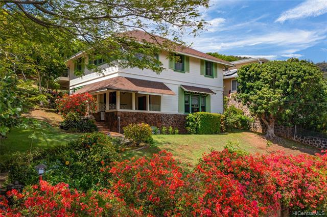 NEW LISTING!! RARE MANOA CHARMER! Serene valley and Diamond Head views await you from this elegant 4 bdrm/4 bath historic residence in highly sought after lower Manoa. Situated on an expansive 13,000 sq. ft. lot, this beautifully and impeccably maintained classic Manoa jewel features almost 2,700 sq. ft. of interior living space, refinished hardwood floors, high ceilings, and sliding doors that lead you from the living room to the covered lanai, perfect for indoor/outdoor entertaining. You'll appreciate the exquisite wood craftmanship with custom built-in cabinetry and detailing. Guests will enjoy the detached studio cottage with its own entry, wet bar and full bath. Just minutes from UH Manoa, shopping, dining, entertainment and Manoa Mark