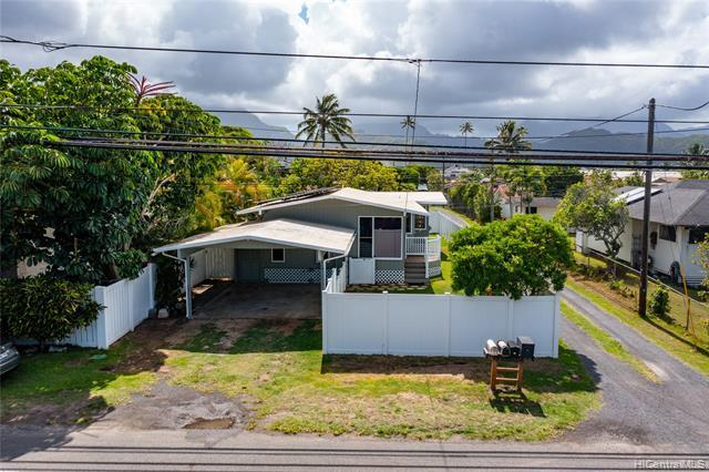Just Remodeled! This 3 bedroom, 2 bath home is located only 1 street away from Kalama Beach Park! Upgraded electrical system with a 23-panel net-metered PV system. Enclosed front and back yards with a carport. Front of the house has 2 bedrooms and a bath off of the living room and kitchen; back of the house has a family room and a master suite with sliding doors to a large lanai. An absolute must see!
